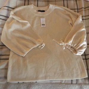 NEW Beautiful cream sweater bell shape sleeve